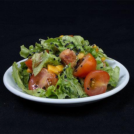 Porción de Ensalada (Lechuga, Tomate, Zanahoria, Aderezo)